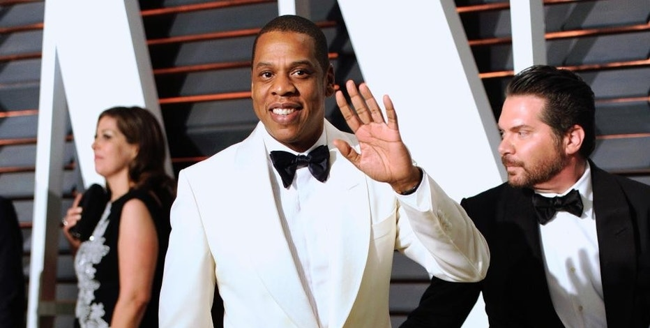 FILE - In this Feb. 23, 2015, file photo, Jay Z arrives at the 2015 Vanity Fair Oscar Party in Beverly Hills, Calif. Jay Z is breaking out his B-sides to hype his fledgling music streaming service. The rap mogul announced plans Wednesday, April 29, 2015, to unleash songs he hasn't performed in a decade, or ever, at a free New York concert to be held on May 13.  (Photo by Evan Agostini/Invision/AP, File)