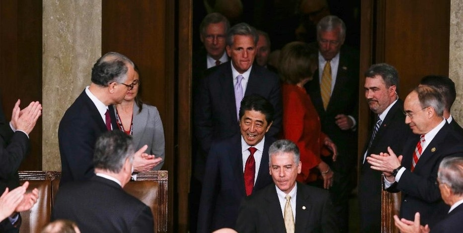Japanese Prime Minister Shinzo Abe, accompanied by Congressional leadership, arrives on Capitol Hill in Washington, Wednesday, April 29, 2015, to speak before a joint meeting of Congress. (AP Photo/Carolyn Kaster)