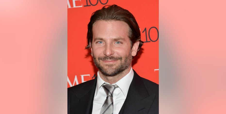 "FILE - In this Tuesday, April 21, 2015 file photo, Bradley Cooper attends the TIME 100 Gala, celebrating the 100 most influential people in the world, at the Frederick P. Rose Hall, Time Warner Center in New York. Cooper met Michelle Aguda, winner of a Chideo contest, at the March 21, 2015, premiere of the film ""Serena."" The actor partnered with Chideo to raise money for a patient care fund established in his father's memory at a New Jersey cancer treatment hospital. (Photo by Evan Agostini/Invision/AP, File)"