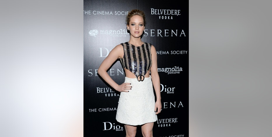 "FILE - In this Saturday, March 21, 2015 file photo, actress Jennifer Lawrence attends a special screening of ""Serena,"" hosted by The Cinema Society and Dior Beauty, at the Landmark Sunshine Cinema, in New York. Lawrence met Michelle Aguda, winner of a Chideo contest, at the premiere. The actress partnered with Chideo to raise money for the Special Olympics World Games, which will be held later this year in Los Angeles. (Photo by Evan Agostini/Invision/AP, File)"