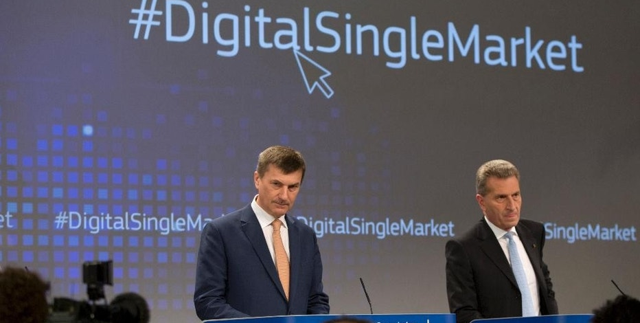 European Commissioner for Digital Single Market Andrus Ansip, left, and European Commissioner for Digital Economy Guenther Oettinger participate in a media conference at EU headquarters in Brussels on Wednesday, May 6, 2015. The EU on Wednesday announced a strategy push to make the continent more relevant on the digital marketplace which is currently dominated by U.S. companies. (AP Photo/Virginia Mayo)