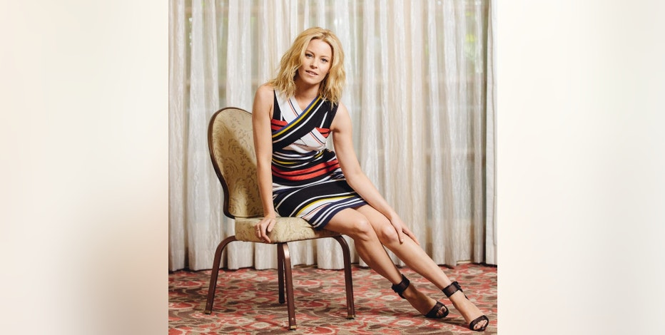 """In this May 2, 2015 photo, Elizabeth Banks poses for a portrait during press day for """"Pitch Perfect 2"""" at The Four Seasons Hotel in Los Angeles. The movie releases in U.S. theaters on May 15, 2015. (Photo by Casey Curry/Invision/AP)"""