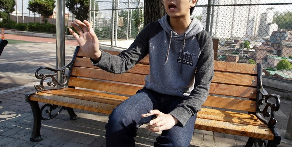 In this May 13, 2015 photo, Cho Jaehyun, a South Korean senior year high school student, speaks during an interview in Seoul, South Korea. Cho got his smartphone at age 10. His parents had a control over his smartphone for a few months through an app when he was young but being monitored didn't teach him by to use his smartphone wisely, he said. (AP Photo/Lee Jin-man)