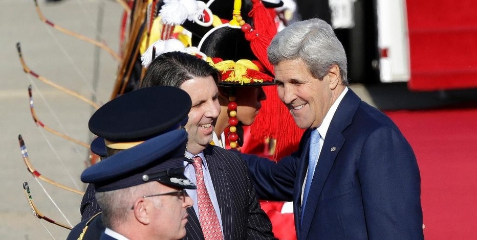 U.S. Secretary of State John Kerry, right, is greeted by U.S. Ambassador to South Korea Mark Lippert upon his arrival at the Seoul Military Airport in Seongnam, South Korea, Sunday, May 17, 2015. As U.S. Secretary of State Kerry wrapped up a visit to China on Sunday, both sides stressed the importance of dialogue to resolve competing claims in the waterway. But neither showed any sign of giving ground over Chinese land reclamation projects that have alarmed the United States and China's smaller neighbors.(AP Photo/Ahn Young-joon)