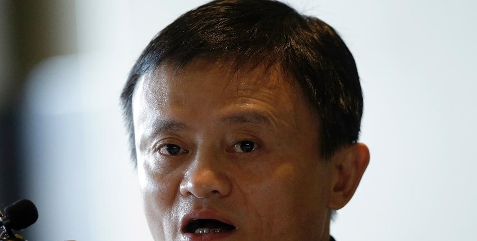 Alibaba Group Executive Chairman Jack Ma answers a reporter's question during a news conference in Seoul, South Korea, Tuesday, May 19, 2015. Ma said it would be better if Kering SA, which owns the Gucci and Yves Saint Laurent brands, collaborated with Alibaba to deal with fake products rather than suing the Chinese e-commerce giant. (AP Photo/Lee Jin-man)