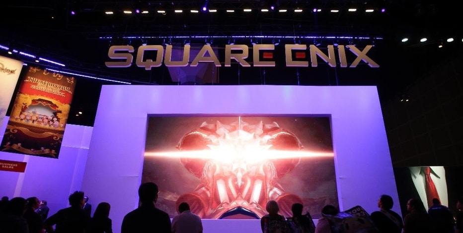 """FILE - In this June 10, 2014 file photo, people watch a video game trailer at the Square Enix booth at the Electronic Entertainment Expo, in Los Angeles.  Bethesda and Square Enix, makers of such video games as """"Fallout"""" and """"Final Fantasy,"""" are among the publishers angling to cut through the noise on the 2015 Electronic Entertainment Expo show floor to promote forthcoming titles by hosting their own flashy E3 briefings. The expo runs June 16-18, 2015, in Los Angeles.  (AP Photo/Jae C. Hong, File)"""