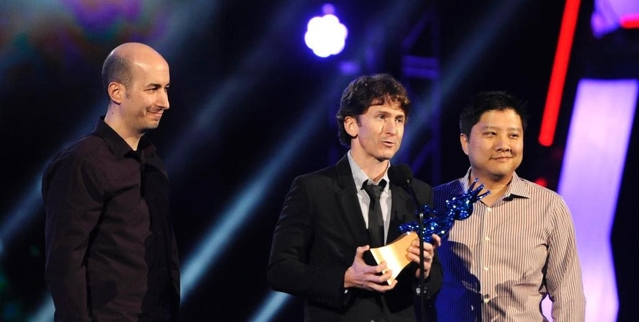 """FILE - In this Dec. 10, 2011 file photo, Todd Howard, center, of Bethesda Game Studios, is joined by members of his team as he accepts the award for game of the year for """"The Elder Scrolls V: Skyrim"""" at Spike TV's Video Game Awards in Culver City, Calif. The publisher of the """"Doom,"""" """"Fallout"""" and """"Elder Scrolls"""" video game series is kicking off this year's Electronic Entertainment Expo, held June 16-18, 2015, with their first-ever E3 press conference, in Los Angeles. (AP Photo/Chris Pizzello, File)"""