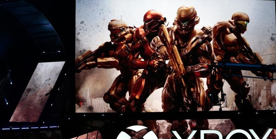 "The ""Halo 5: Guardians"" video game is showcased at the Xbox E3 2015 briefing ahead of the Electronic Entertainment Expo at the University of Southern California's Galen Center on Monday, June 15, 2015 in Los Angeles. The game comes out on Oct. 27 and features a multiplayer zone with up to 24 live players and maps four times the size of previous versions. (AP Photo/Damian Dovarganes)"