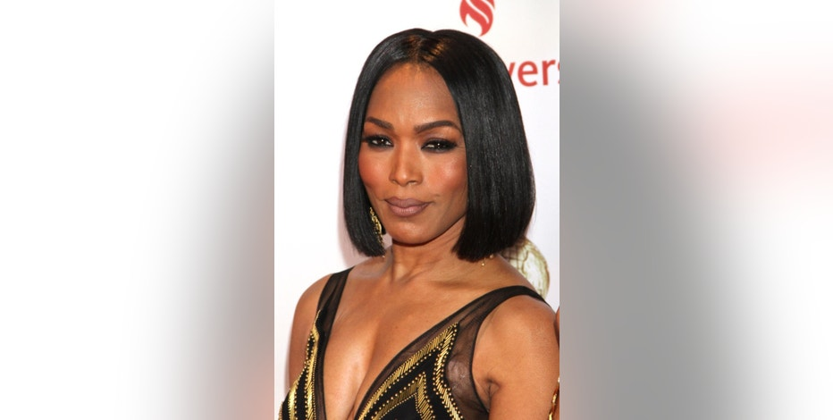 "FILE - In this Feb. 6, 2015 file photo, Angela Bassett arrives at the 46th NAACP Image Awards at the Pasadena Civic Auditorium, in Pasadena, Calif. Bassett was unveiled Monday, June 15, 2015, during Ubisoft's press conference at the Electronic Entertainment Expo as the latest ""Six"" in the upcoming ""Rainbow Six: Siege"" installment of the publisher's long-running shooter series. The character has always been portrayed as male in past ""Rainbow Six"" games, as well as Clancy's original novel. (Photo by Arnold Turner/Invision/AP, File)"