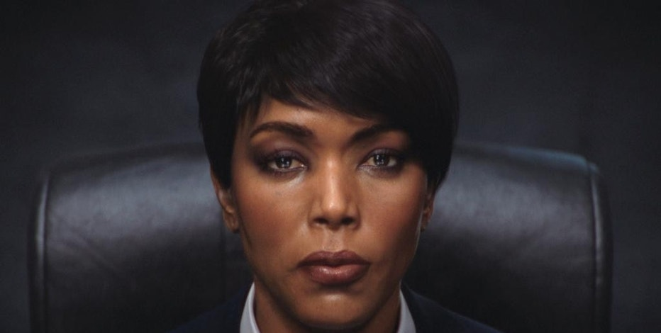 """This photo provided by Ubisoft shows Angela Bassett's character in the video game, """"Rainbow Six: Siege."""" Bassett was unveiled Monday, June 15, 2015, during Ubisoft's press conference at the 2015 Electronic Entertainment Expo as the latest """"Six"""" in the upcoming """"Rainbow Six: Siege"""" installment of the publisher's long-running shooter series. The character has always been portrayed as male in past """"Rainbow Six"""" games, as well as Clancy's original novel. (Ubisoft via AP)"""