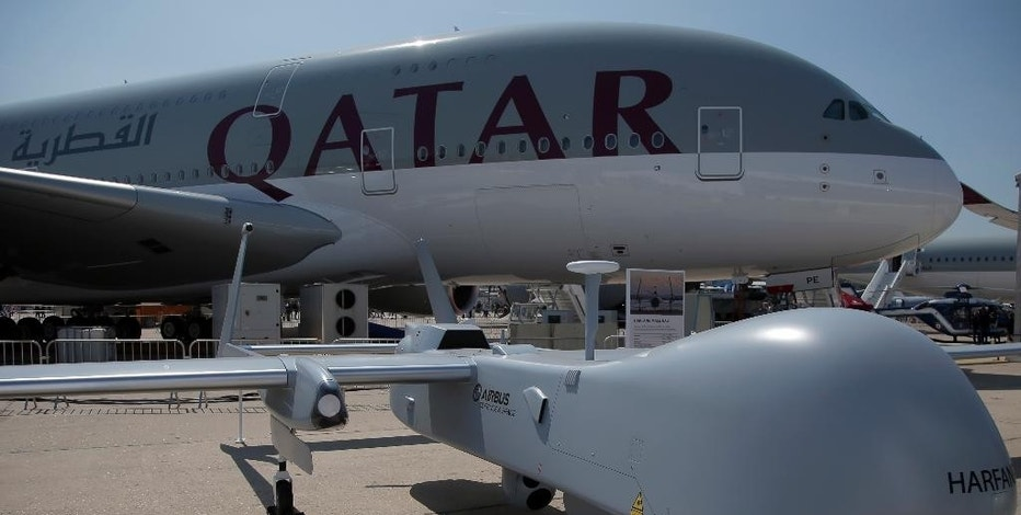 An Harfang Male UAS drone is displayed in front the Airbus A380 of Qatar Airways at the Paris Air Show, in Le Bourget airport, north of Paris, Wednesday, June 17, 2015. Some 300,000 aviation professionals and spectators are expected at this week's Paris Air Show, coming from around the world to make business deals and see dramatic displays of aeronautic prowess and the latest air and space technology. (AP Photo/Francois Mori)