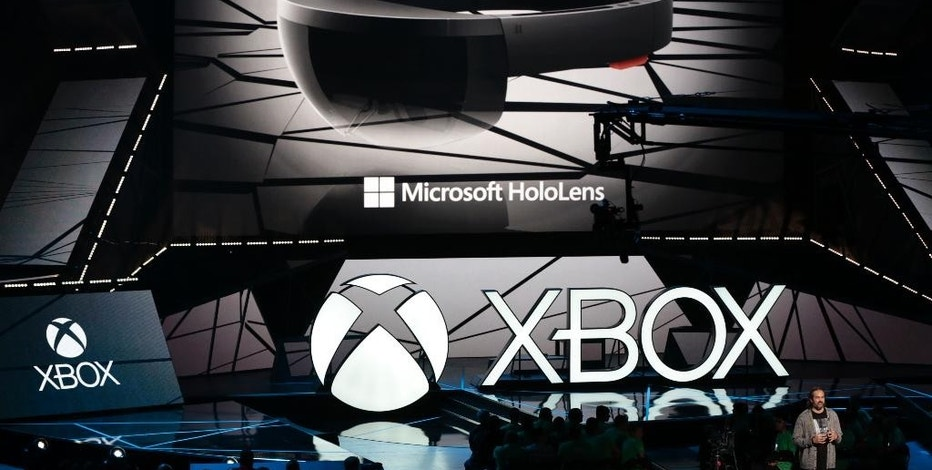 """The Microsoft HoloLens is showcased at the Xbox E3 2015 briefing ahead of the Electronic Entertainment Expo (E3) at the University of Southern California's Galen Center on Monday, June 15, 2015 in Los Angeles. Microsoft is promoting the next installment in its popular sci-fi franchise, """"Halo 5: Guardians,"""" at the Electronic Entertainment Expo. (AP Photo/Damian Dovarganes)"""