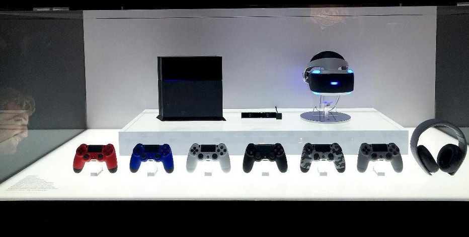 Sony PlayStation 4 wireless controllers are displayed at the E3 Electronic Entertainment Expo at Los Angeles Convention Center on Tuesday, June 16, 2015, in Los Angeles. (AP Photo/Damian Dovarganes)