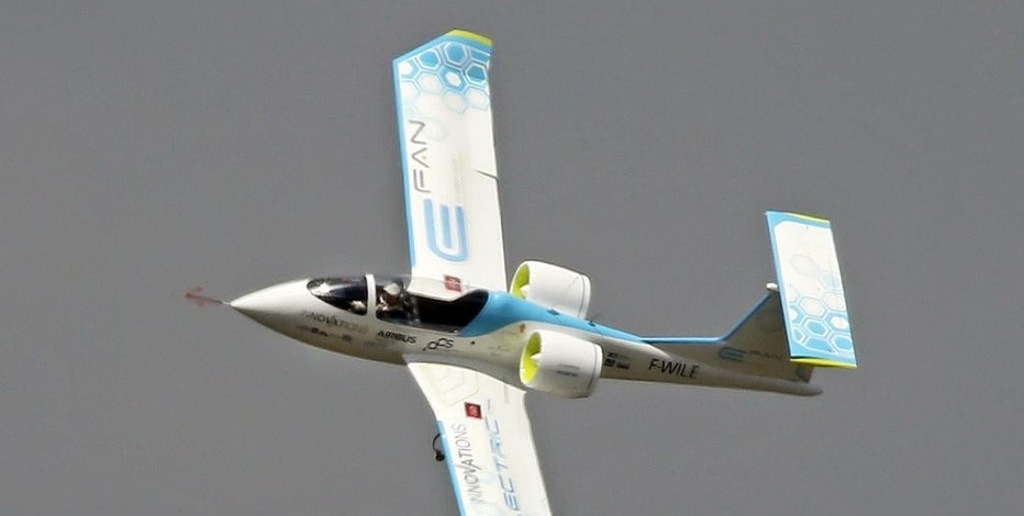 An Efan 1 electric plane performs its demonstration flight at the Paris Air Show in Le Bourget, north of Paris, Friday, June 19, 2015. The Efan is a two-seat experimental electric aircraft developed by Airbus Group and partners. Some 300,000 aviation professionals and spectators are expected at this week's Paris Air Show, coming from around the world to make business deals and see dramatic displays of aeronautic prowess and the latest air and space technology. (AP Photo/Remy de la Mauviniere)