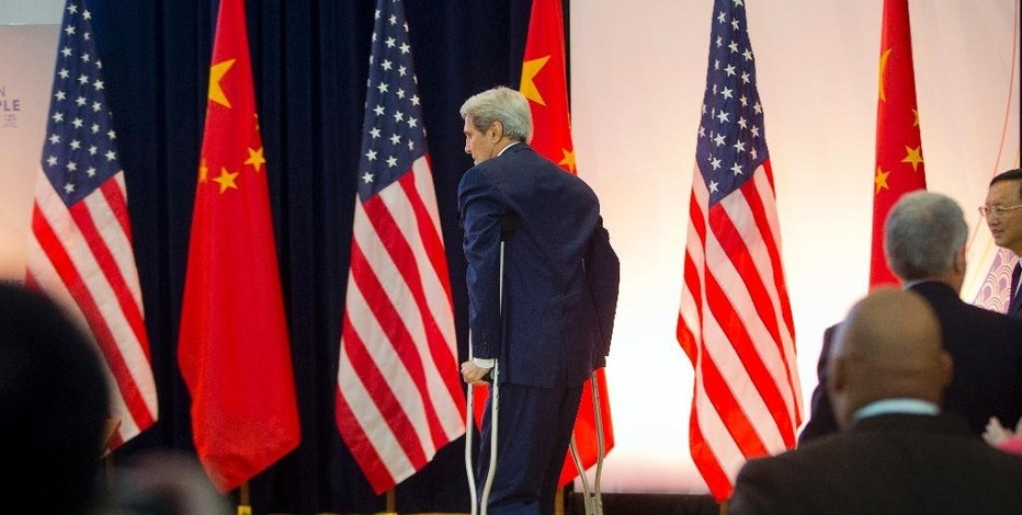 US Secretary of State John Kerry uses crutches while walking on stage to participate at the 7th US China Strategic and Economic Dialogue  (S&ED) and 6th Consultation on People-to-People (CPE) at the U.S. State Department in Washington, Tuesday, June 23, 2015. (AP Photo/Pablo Martinez Monsivais)