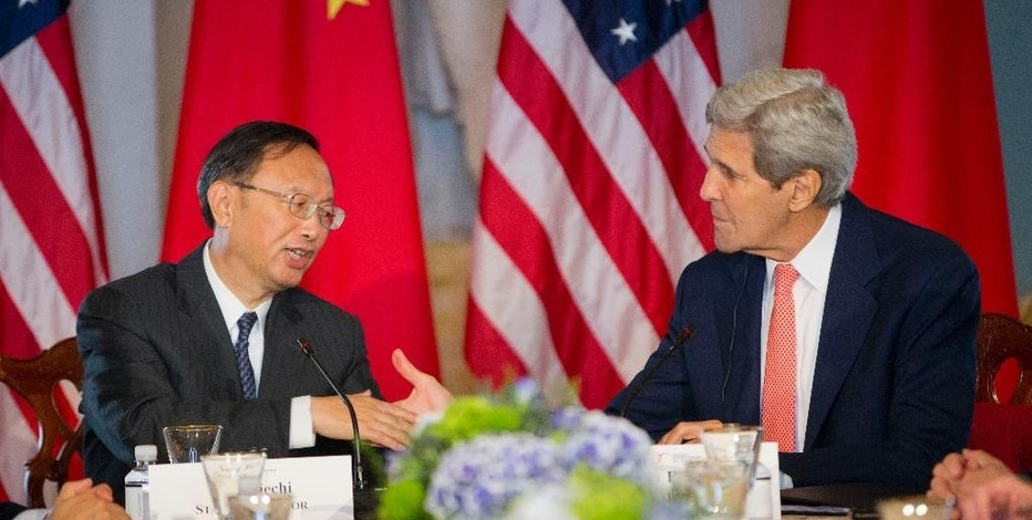 Secretary of State John Kerry shakes hands with China's State Councilor Yang Jiechi during the Strategic Track Ocean meeting during the US China Strategic and Economic Dialogue (S&ED), Wednesday, June 24, 2015, at the State Department in Washington. (AP Photo/Pablo Martinez Monsivais)