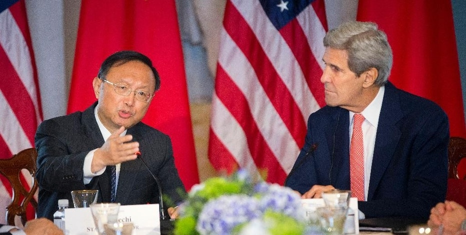 Secretary of State John Kerry listens as China's State Councilor Yang Jiechi speaks at the Strategic Track Ocean meeting during the US China Strategic and Economic Dialogue (S&ED), Wednesday, June 24, 2015, at the State Department in Washington. (AP Photo/Pablo Martinez Monsivais)