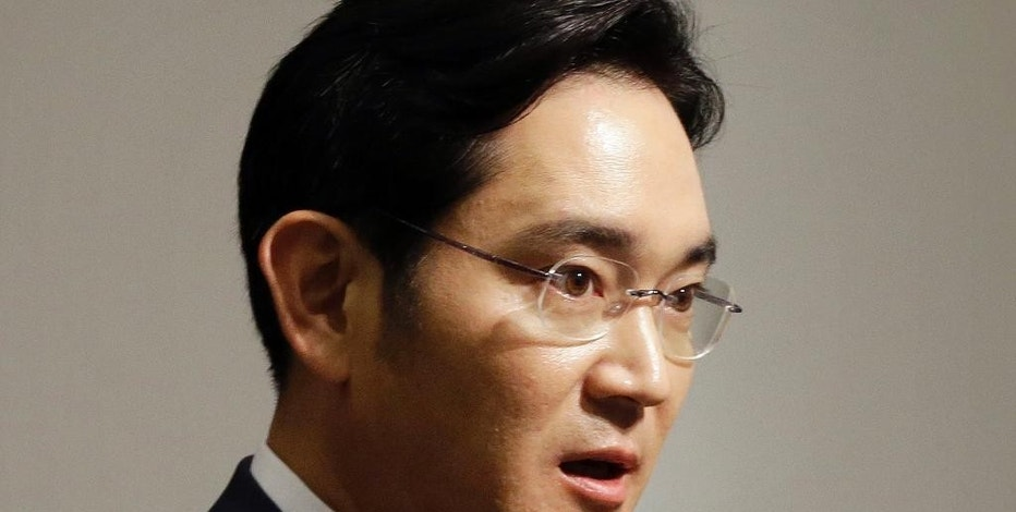 In this June 23, 2015, Lee Jae-yong, vice chairman of Samsung Electronics Co., speaks during a press conference at the company's headquarters in Seoul, South Korea. Thousands of South Korean investors are backing an American hedge fund's bid to thwart a business combination between Samsung companies that they argue will only enrich the conglomerate's wealthy founding family. (AP Photo/Ahn Young-joon)