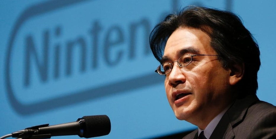 FILE - In this Jan. 31, 2013 file photo, Nintendo Co. President Satoru Iwata speaks during a news conference in Tokyo. Nintendo said President Iwata died Saturday, July 11, 2015, of a bile duct tumor in a Kyoto hospital, western Japan. (AP Photo/Koji Sasahara, File)