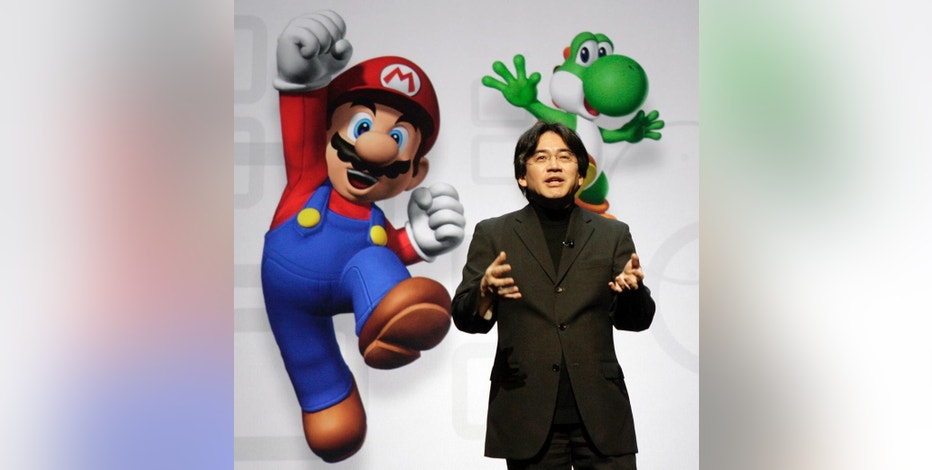 FILE - In this July 15, 2008 file photo, Satoru Iwata, President and CEO of Nintendo Co. Ltd., speaks at a news conference where Nintendo unveiled an enhancement for its Wii Remote controller and new games at the E3 Media and Business Summit in Los Angeles.  Nintendo said President Iwata died Saturday, July 11, 2015, of a bile duct tumor in a Kyoto hospital, western Japan. (AP Photo/Ric Francis, File)