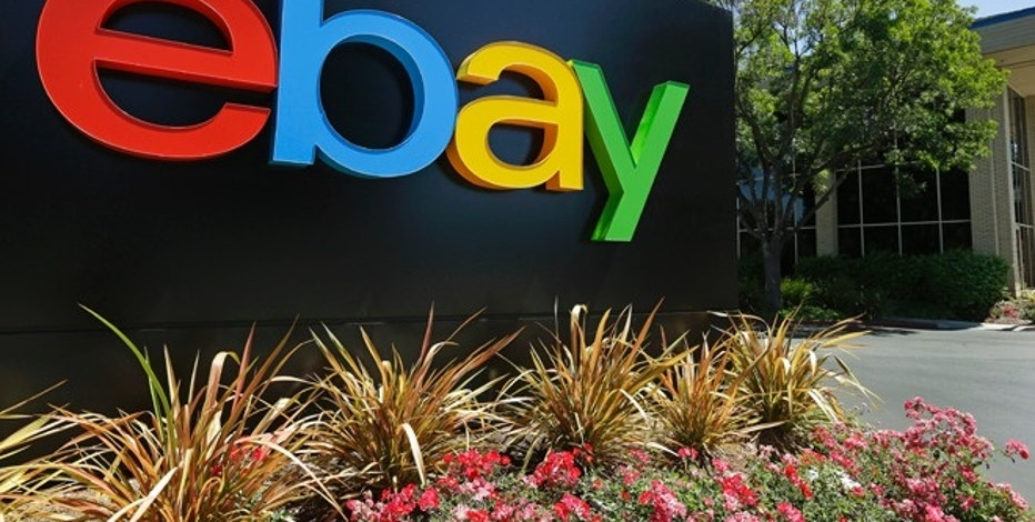 FILE - This Tuesday, July 16, 2013, file photo shows signage at eBay headquarters in San Jose, Calif. EBay Inc. reports quarterly financial results on Wednesday, Oct. 15, 2014. (AP Photo/Ben Margot, File)
