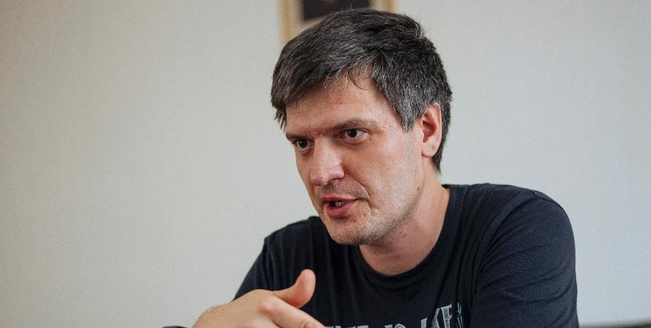 In this Monday, June  8, 2015 photo, physicist Alexander Shilov speaks during an interview in Novosibirsk, Russia. Hundreds of Russian scientists are reporting experiences of being refused sale of scientific equipment from abroad, or seeing research papers turned down by Western publications. The reason, they believe, is a combination of sanctions against Russia over its actions in Ukraine and rising hostility to Russia in the West seeping into the scientific community. (AP Photo/Alexander Lukin)