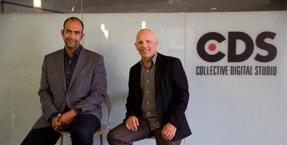 In this Thursday, July 9, 2015 photo, Reza Izad, left, CEO of Collective Digital Studio, and chairman Michael Green pause for photos in Beverly Hills, Calif. YouTubers and companies that manage them are on the hunt for new ways to make money from the audiences they've built on the platform, which takes about a 45 percent cut of ad revenue. (AP Photo/Jae C. Hong)