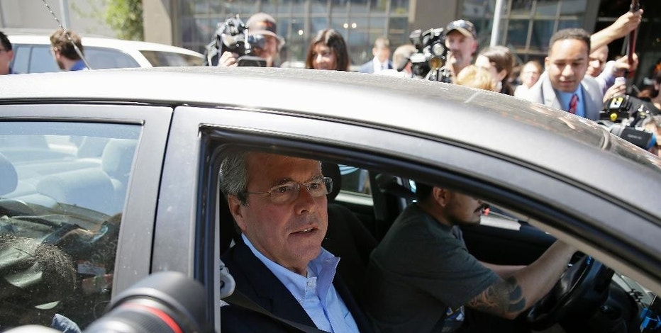 "FILE - In this July 16, 2015, file photo, Republican presidential candidate, former Florida Gov. Jeb Bush, puts on his seat belt getting into an Uber car after speaking at Thumbtack, an online startup in San Francisco. The debate over ride-hailing firm Uber is laying bare divides in the Democratic Party and on the left about how to handle the new ""sharing"" economy. Republicans are hungry to exploit that ambivalence and make inroads into a wealthy sector of the tech industry. (AP Photo/Eric Risberg, File)"