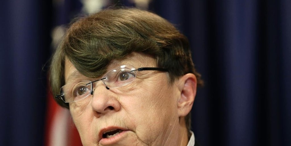 Commissioner of the U.S. Security Exchange Commission Mary Jo White speaks during a news conference in Newark, N.J., Tuesday, Aug. 11, 2015. An international group of hackers and stock traders made $30 million by breaking into the computers of newswire services that put out corporate press releases and trading on the information before it was made public, federal prosecutors said Tuesday. (AP Photo/Seth Wenig)