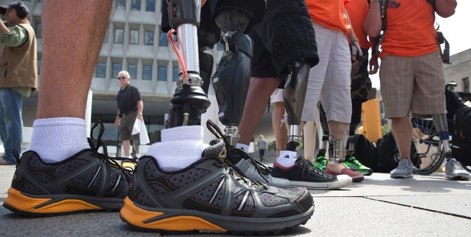People with artificial limbs attend a rally with the Amputee Coalition against a Medicare change in payment policy for lower limb prosthetics including artificial feet, in Washington, Wednesday, Aug. 26, 2015. Mounting cost in the last 10 years, even as the number of amputees went down, has prompted scrutiny from government investigators. Now, Medicare's billing contractors are proposing closer supervision and tighter rules. (AP Photo/Jacquelyn Martin)