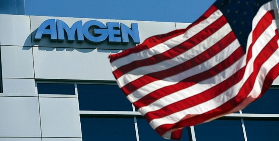 An Amgen sign is seen at the company's office in South San Francisco, California October 21, 2013. The biopharmaceutical company reports earnings on Tuesday. REUTERS/Robert Galbraith  (UNITED STATES - Tags: BUSINESS HEALTH SCIENCE TECHNOLOGY LOGO) - RTX14J0R