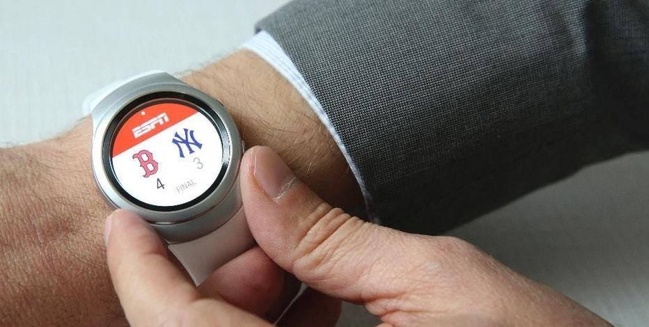 This Tuesday, Sept. 1, 2015, photo shows a baseball score on the ESPN app running on Samsung's Gear S2 during a presentation in New York. Samsung says it expects about 1,000 apps to be available when the S2 launches. (AP Photo/Mary Altaffer)