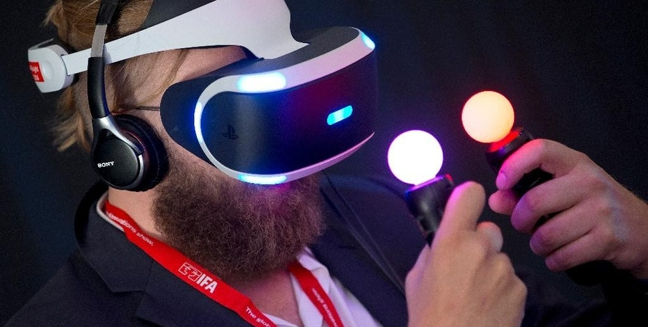 A man tests a Sony 'Project Morpheus Virtual Reality' device after a press conference at the company's stand at the IFA 2015 tech fair in Berlin, Germany, Wednesday, Sept. 2, 2015. (AP Photo/Michael Sohn
