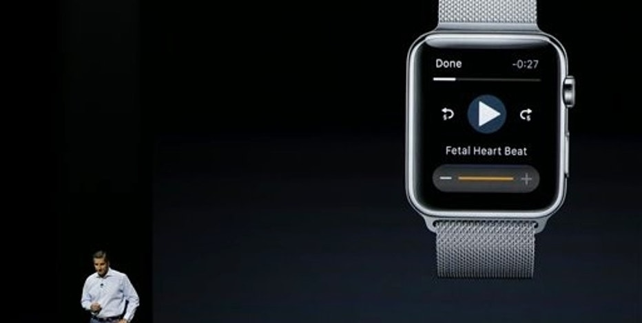 Dr. Cameron Powell with Airstrip, talks about fetal heart monitor options on the Apple Watch during the Apple event at the Bill Graham Civic Auditorium in San Francisco, Wednesday, Sept. 9, 2015. (AP Photo/Eric Risberg)