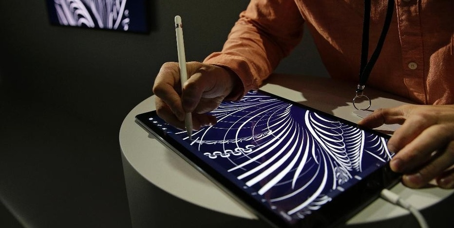 The Apple Pencil is used on on the new iPad Pro and then shown on Apple TV during a product display following an Apple event Wednesday, Sept. 9, 2015, in San Francisco. Apple staked a new claim to the living room on Wednesday, as the maker of iPhones and other hand-held gadgets unveiled an Internet TV system that's designed as a beachhead for the tech giant's broader ambitions to deliver a wide range of information, games, music and video to the home. (AP Photo/Eric Risberg)