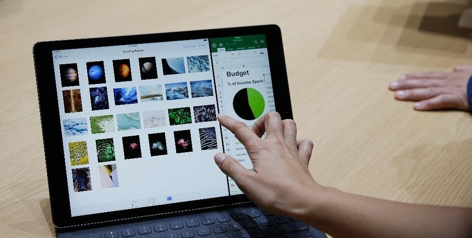 The new iPad Pro with a Smart Keyboard is displayed following an Apple event Wednesday, Sept. 9, 2015, in San Francisco. Apple staked a new claim to the living room on Wednesday, as the maker of iPhones and other hand-held gadgets unveiled an Internet TV system that's designed as a beachhead for the tech giant's broader ambitions to deliver a wide range of information, games, music and video to the home. (AP Photo/Eric Risberg)