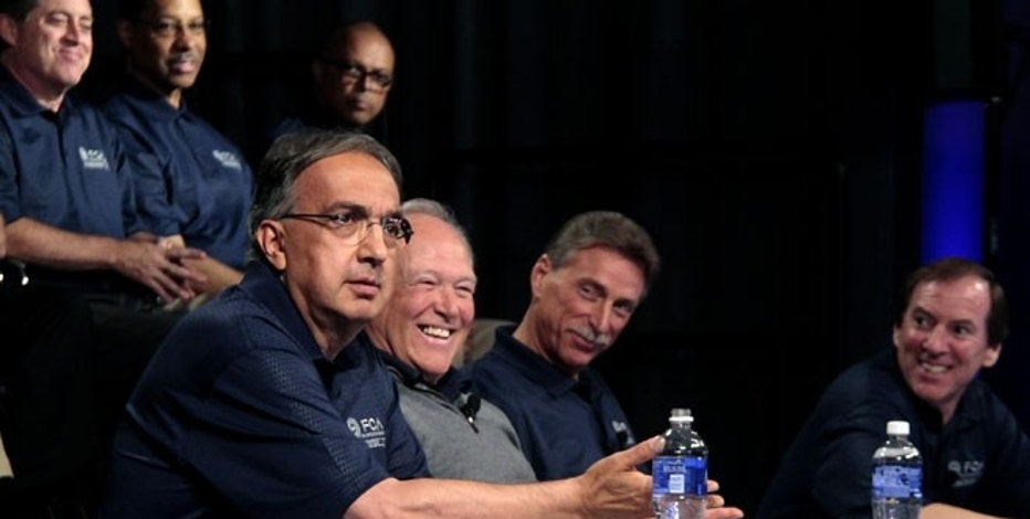 Fiat Chrysler Automobiles CEO Sergio Marchionne (far left) and UAW President Dennis Williams mark the beginning of contract negotiations in July 2015.