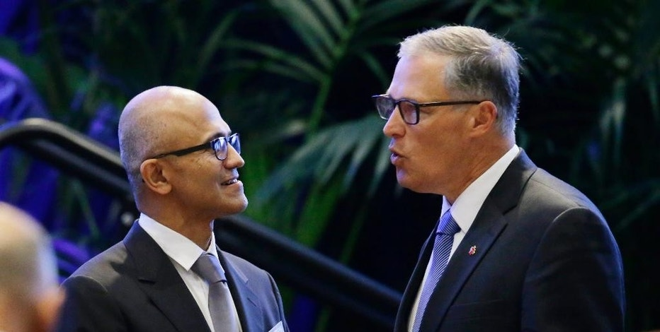 Microsoft CEO Satya Nadella, left, talks with Washington Gov. Jay Inslee, right, during a banquet for Chinese President Xi Jinping, Tuesday, Sept. 22, 2015, in Seattle. (AP Photo/Ted S. Warren)