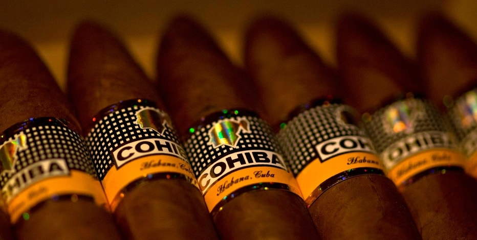Samples of Cohiba cigars sit on display at a cigar club shop in Havana, Cuba, Friday, Dec. 19, 2014.