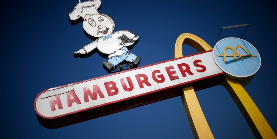 The signage outside a historic McDonald's restaurant is seen in Downey, California February 18, 2015.