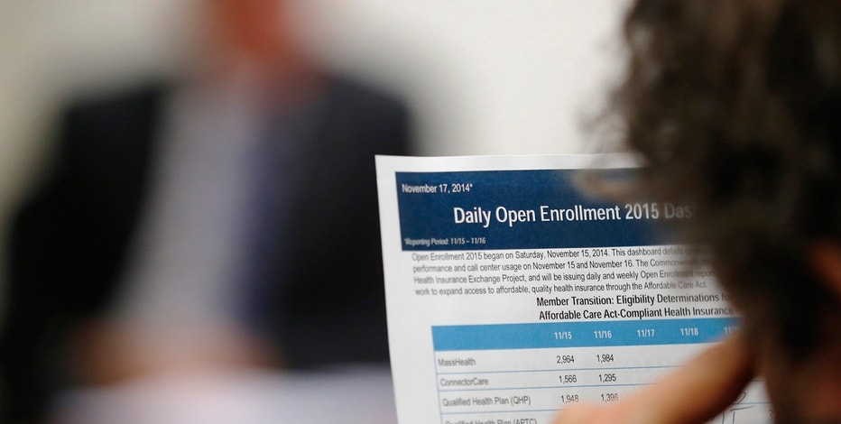 A reporter reads a summary of the performance and usage over the first two days of open enrollment of the Massachusetts Health Connector website