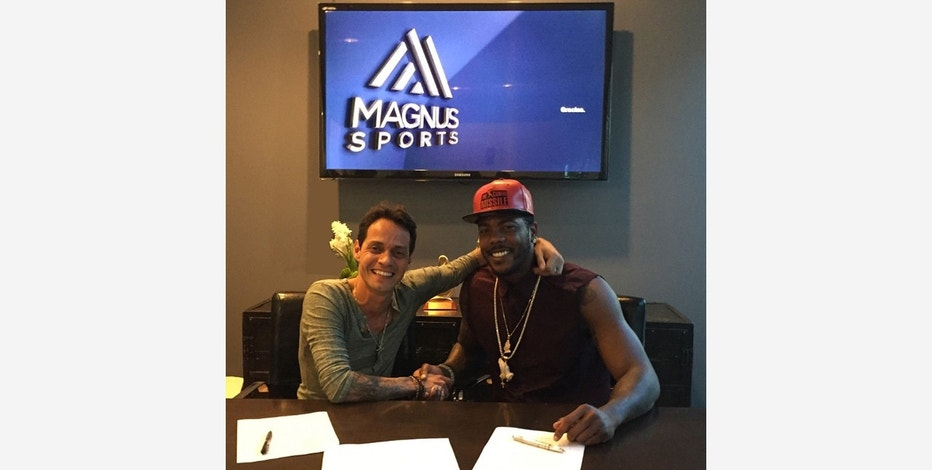 Marc Anthony and MLB pitcher Aroldis Chapman at Magnus Media and Magnus Sports headquarters in Miami.
