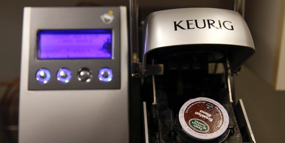 A single-serve Keurig Green Mountain brewing machine is seen before dispensing coffee in New York February 6, 2015. Sales of coffee pods for the slick single-serve machines like Keurig Green Mountain's Keurig, Nestle's Nespresso, and Starbucks' Verismo soared to $3.8 billion in 2014 from $234 million in 2009, Mintel market research data shows. Keurig, the maker of the most popular machine, has seen its shares rise to about $118.90 on Friday from about $9 in February 2009. Picture taken February 6, 2015. To match Insight COFFEE-KCUP/  REUTERS/Shannon Stapleton (UNITED STATES - Tags: BUSINESS FOOD SOCIETY) - RTR4OOA6