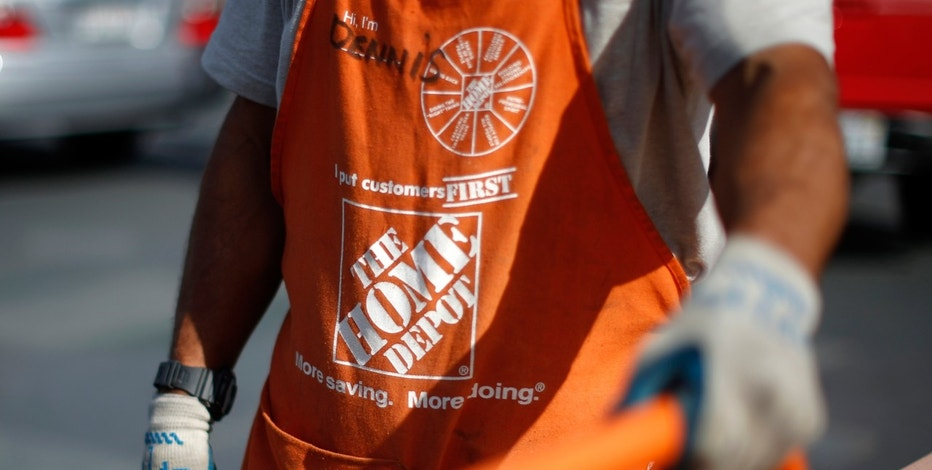 A Home Depot employee is seen outside a store in Los Angeles, California.