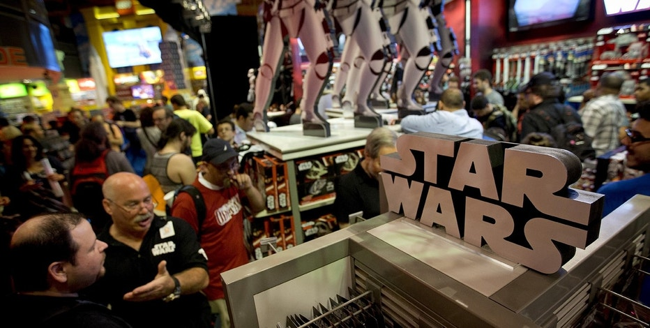 "People shop for Star Wars toys at Toys R Us just after midnight in advance of the film ""Star Wars: The Force Awakens"" in Times Square in the Manhattan borough of New York, September 4, 2015."