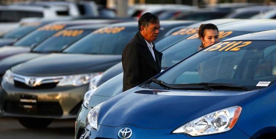 People look at vehicles for sale on the lot at AutoNation Toyota dealership in Cerritos, California
