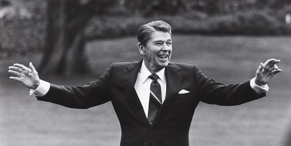 Reagan is pictured waving to well-wishers on the south lawn of the White House on April 25, 1986, before departing for a summit in Tokyo.