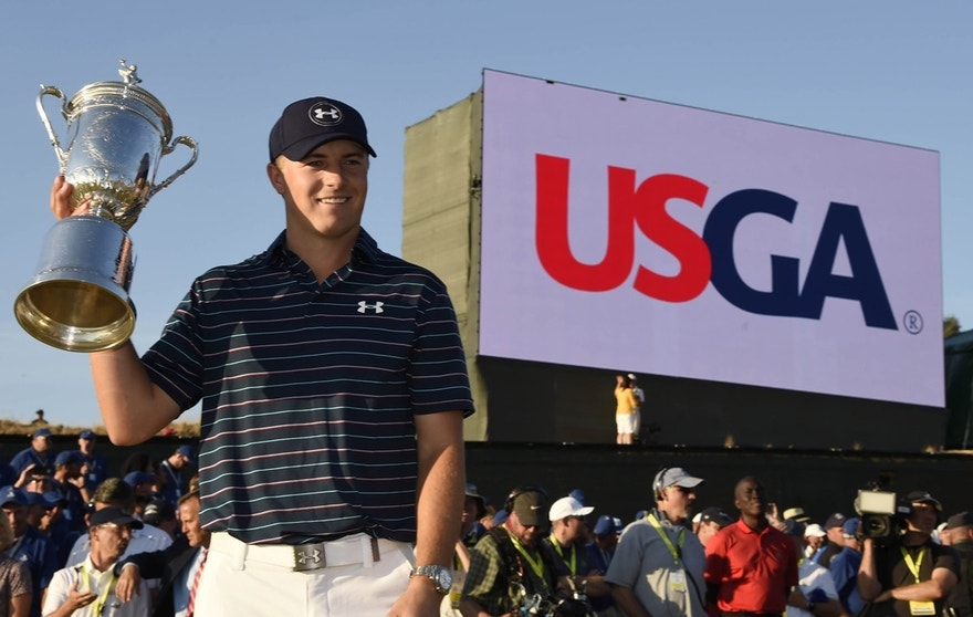 Jordan Spieth poses for a photo with the U.S. Open Championship Trophy after winning the 2015 U.S. Open golf tournament at Chambers Bay.