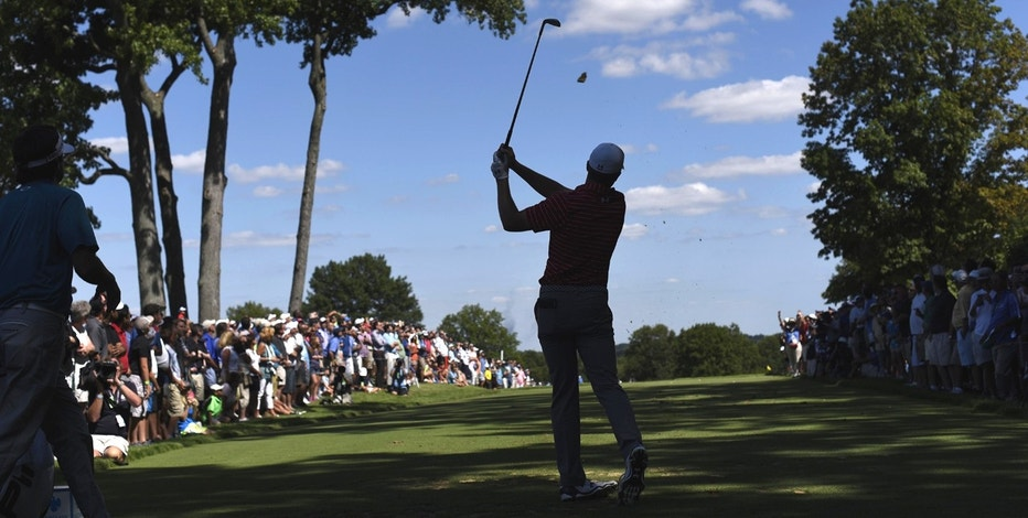Jordan Spieth teeing off, New Jersey golf course