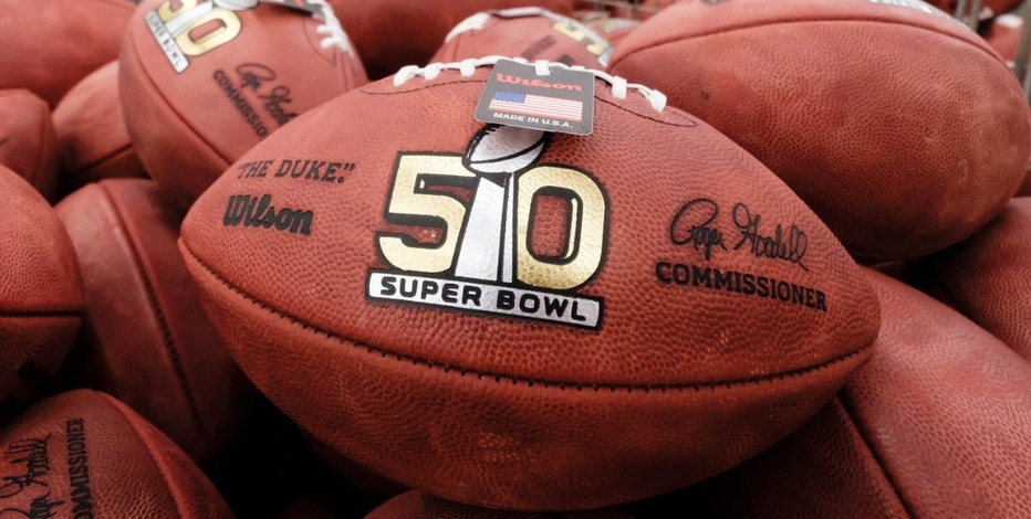 Official balls for the NFL Super Bowl 50 football game are seen in a bin prior to final inspection at the Wilson Sporting Goods Co. in Ada, Ohio, Tuesday, Jan. 26, 2016. The Denver Broncos will play the Carolina Panthers in the Super Bowl on Feb. 7 in Santa Clara, Calif.  (AP Photo/Rick Osentoski)